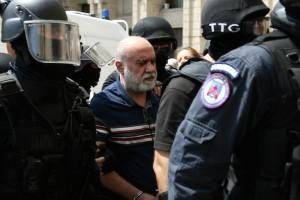 Omar Hayssam este adus la sediul Direcţiei de Investigare a Infracţiunilor de Criminalitate Organizată şi Terorism (DIICOT), in Bucuresti, vineri, 2 august 2013. El a fost readus în România din Siria. foto: Liviu Adascalitei / Mediafax Foto