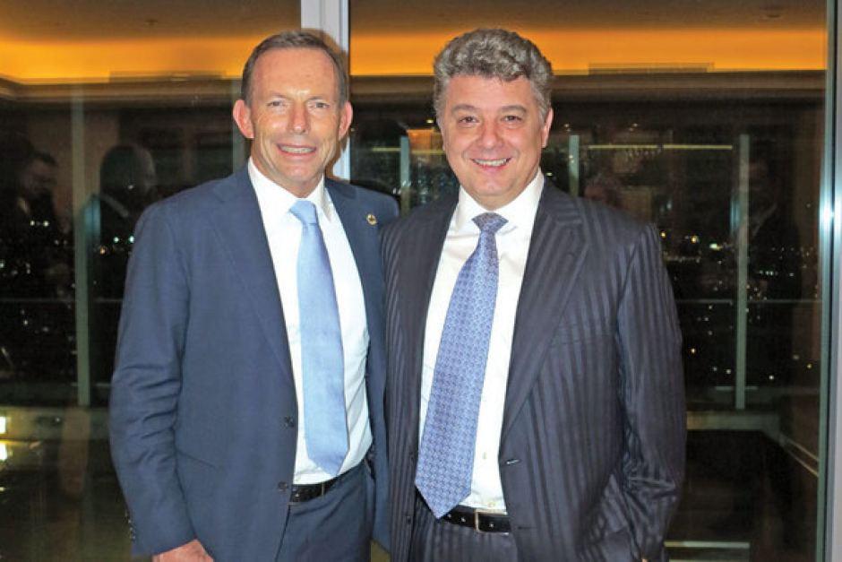 Florin Burhală (în dreapta) și fostul premier australian Tony Abbott. Fofo: ABC News